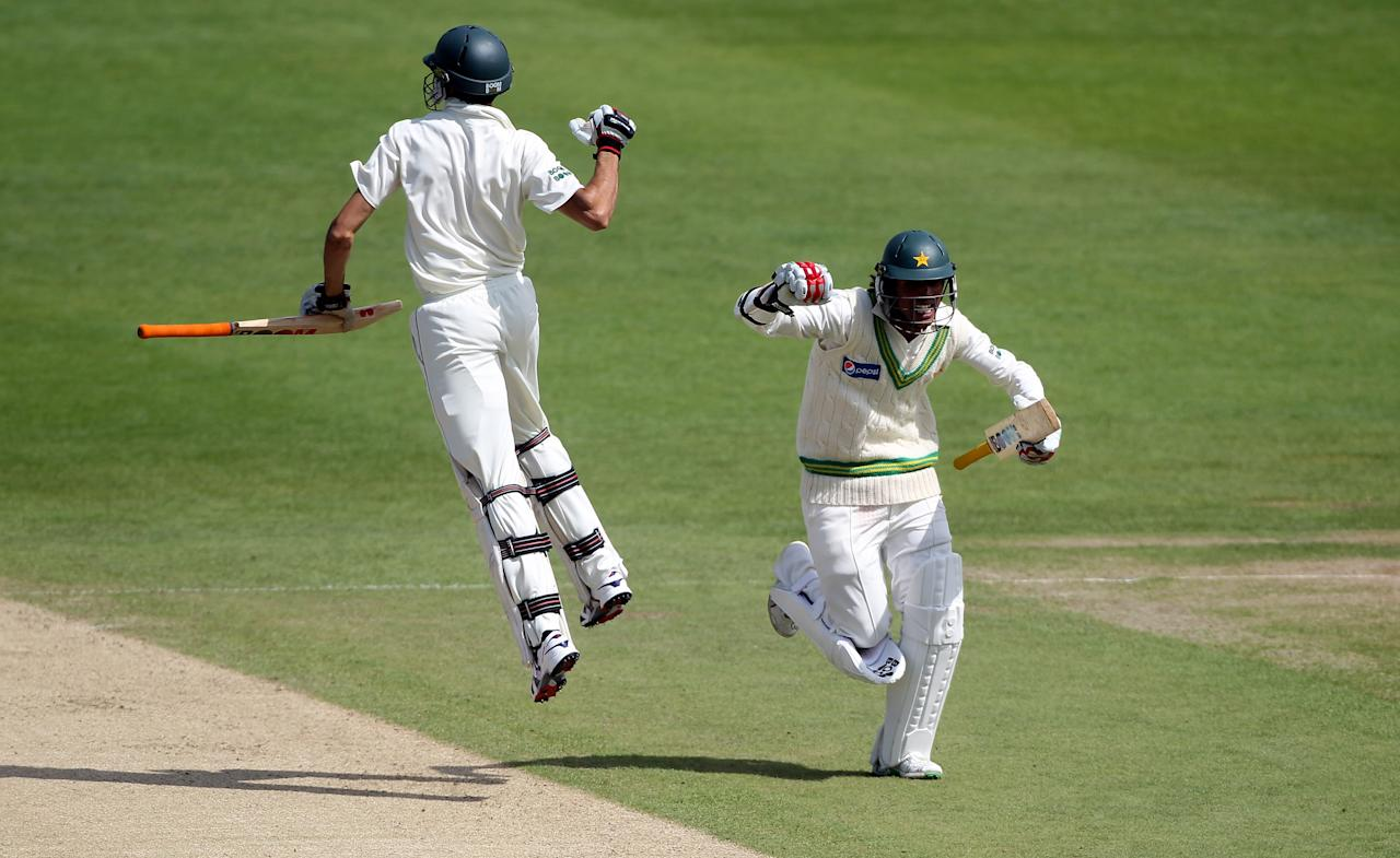 LEEDS, ENGLAND - JULY 24: Mohammad Aamer runs as Umar Gul jumps at the end of day four of the 2nd Test between Pakistan and Australia at Headingley Carnegie Stadium on July 24, 2010 in Leeds, England.  (Photo by Julian Herbert/Getty Images)