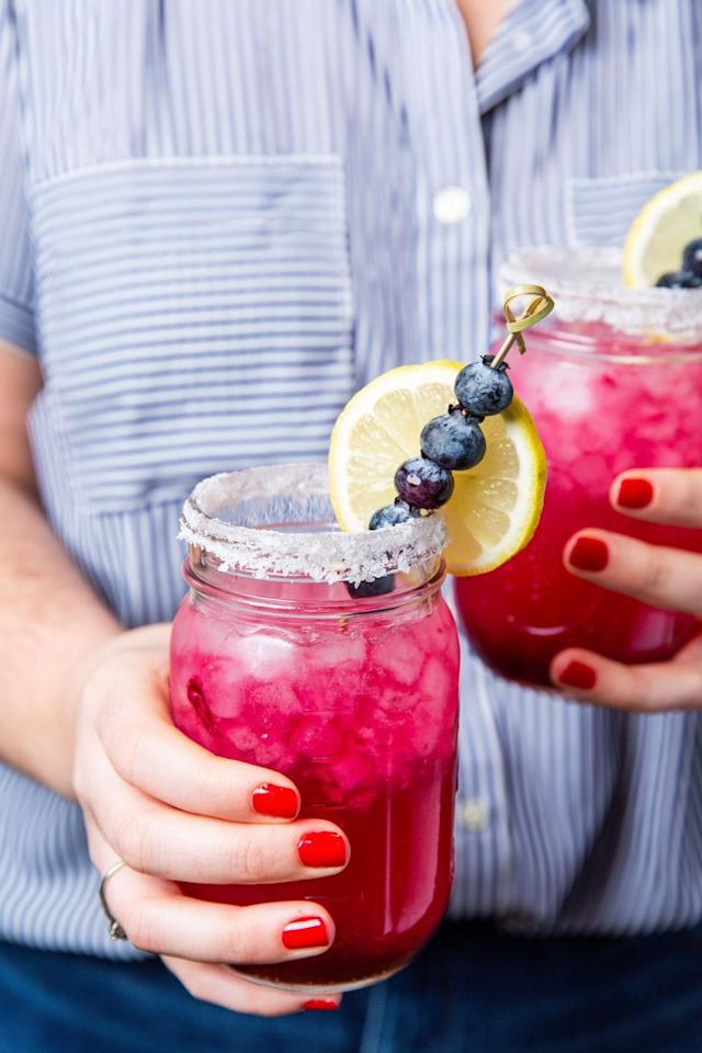 "<p>Turn your <a href=""https://www.delish.com/uk/cocktails-drinks/a30893337/best-classic-margarita-recipe/"">Margarita</a> into summer goals with this blueberry lemonade version. It's just what you've been missing. Have some leftover blueberry simple syrup? It tastes AMAZING in sparkling water, and is a great sweetener for iced tea. You can even stir it into yogurt or ice cream for a punch of blueberry flavour. </p><p>Get the <a href=""https://www.delish.com/uk/cocktails-drinks/a33333336/blueberry-lemonade-margaritas-recipe/"" target=""_blank"">Blueberry Lemonade Margaritas</a> recipe.</p>"