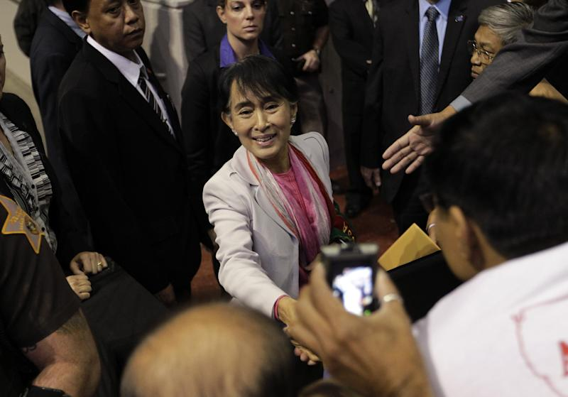 Myanmar democracy leader Aung San Suu Kyi shakes hands with supporters after speaking in Fort Wayne, Ind., Tuesday, Sept. 25, 2012. Fort Wayne is home to one of the United States' largest Myanmar populations. (AP Photo/Michael Conroy)