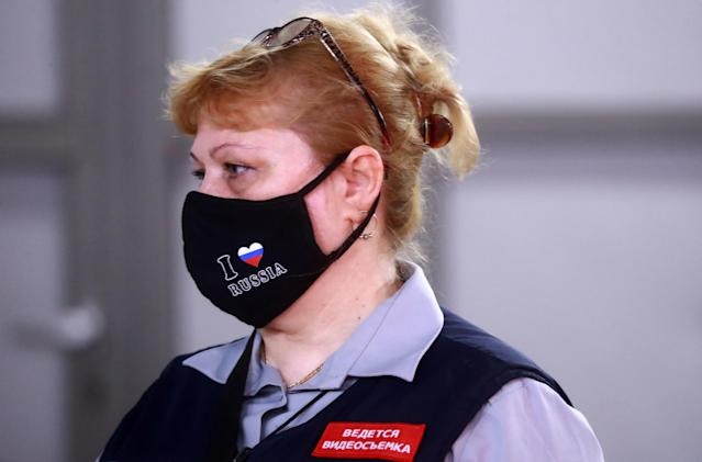 A station worker wears a mask in Moscow. (Getty Images)