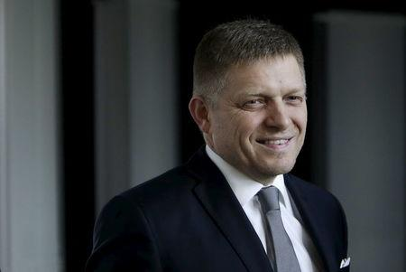 Slovakia's Prime Minister and leader of Smer party Robert Fico leaves after a live broadcast of a debate after the country's parliamentary election, in Bratislava