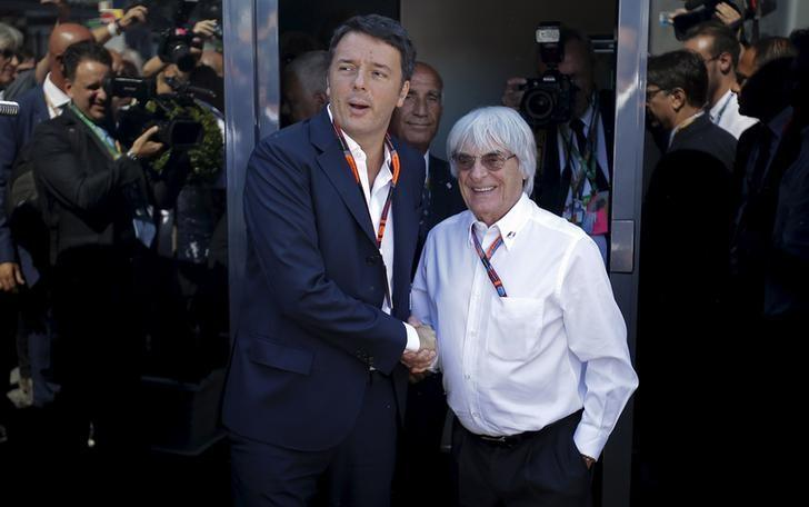 Italian Prime Minister Renzi shakes hands with Formula One supremo Bernie Ecclestone during the Italian F1 Grand Prix in Monza