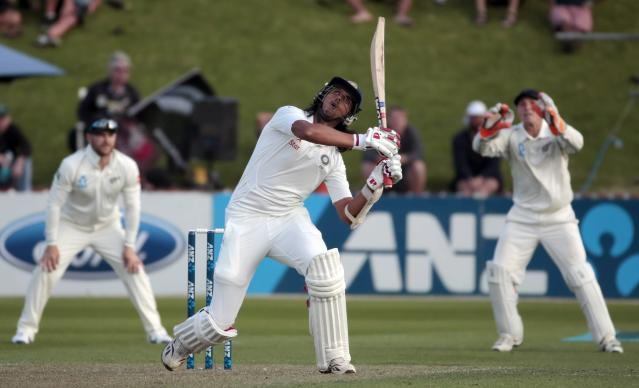 India's Ishant Sharma plays a shot against New Zealand during the first innings on day one of the second international test cricket match at the Basin Reserve in Wellington, February 14, 2014. REUTERS/Anthony Phelps (NEW ZEALAND - Tags: SPORT CRICKET)