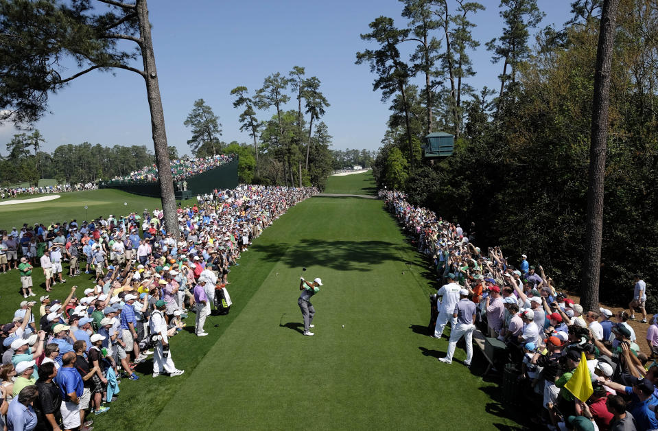 Tiger Woods tees off on the 18th hole during a practice round for the Masters golf tournament Wednesday, April 8, 2015, in Augusta, Ga. (AP Photo/David J. Phillip)