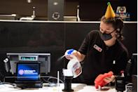 <p>An employee cleans the counter at the AMC Highlands Ranch 24 on August 20 in Highlands Ranch, Colorado.</p>