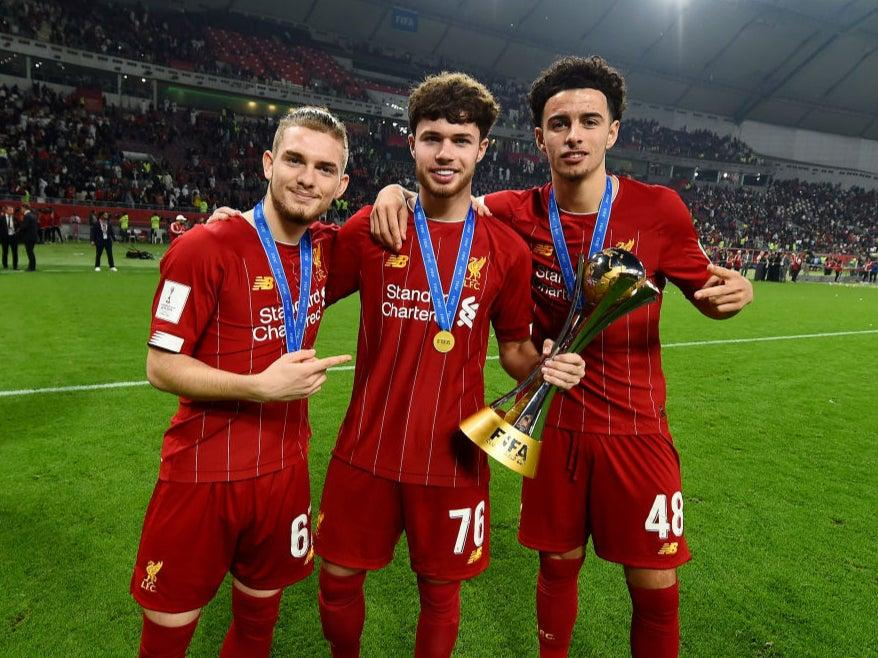 Neco Williams (centre) poses with Club World Cup trophyLiverpool FC via Getty Images