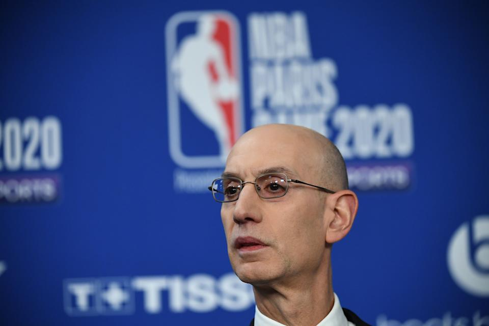 NBA commissioner Adam Silver took a hard stance on players in violation of local COVID-19 vaccine mandates. (Franck Fife/AFP via Getty Images)