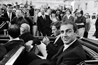<p>James Bond actor Sean Connery smiles at the camera as he arrives at a film premiere on May 24th, 1965.</p>