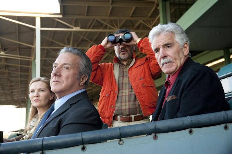 """In this undated image released by HBO, from left, Joan Allen, Dustin Hoffman, John Ortiz and Dennis Farina are shown in a scene from the HBO original series """"Luck."""" HBO cancelled horse racing series """"Luck"""" on Wednesday, a day after a third horse died during the production of the series that starred Dustin Hoffman and Nick Nolte. (AP Photo/HBO, Gusmano Cesaretti )"""