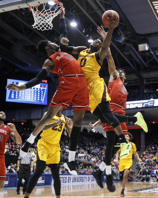 Arizona State's Luguentz Dort, center right, shoots against St. John's Sedee Keita, center left, during the first half of a First Four game of the NCAA men's college basketball tournament Wednesday, March 20, 2019, in Dayton, Ohio. (AP Photo/John Minchillo)