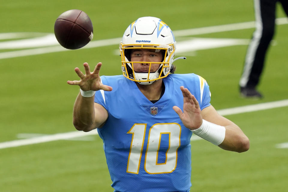 Los Angeles Chargers quarterback Justin Herbert pitches the ball during the first half of an NFL football game against the Jacksonville Jaguars Sunday, Oct. 25, 2020, in Inglewood, Calif. (AP Photo/Alex Gallardo)