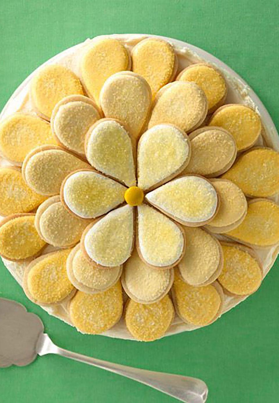 """<p>This bright and cheery cake (made with almond extract instead of vanilla) will make Mom's day!</p><p><a href=""""https://www.womansday.com/food-recipes/food-drinks/recipes/a11896/daisy-cake-recipe/"""" rel=""""nofollow noopener"""" target=""""_blank"""" data-ylk=""""slk:Get the Daisy Cake recipe."""" class=""""link rapid-noclick-resp""""><strong><em>Get the Daisy Cake recipe.</em></strong></a></p>"""