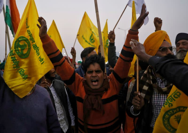 Farmers shout slogans during a protest against farm laws at Ghaziabad