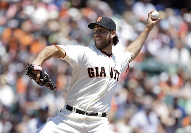 San Francisco Giants starting pitcher Madison Bumgarner throws against the San Diego Padres in the first inning of their baseball game Wednesday, June 19, 2013 in San Francisco. (AP Photo/Eric Risberg)