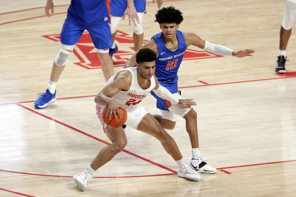 Houston guard Quentin Grimes (24) looks to drive around Boise State guard RayJ Dennis (10) during the first half of an NCAA college basketball game Friday, Nov. 27, 2020, in Houston. (AP Photo/Michael Wyke)