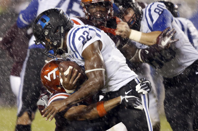 FILE - In this Oct. 28, 2017, file photo, Duke running back Brittain Brown (22) slips past Virginia Tech defensive back Mook Reynolds (6) during the second half of an NCAA college football game in the rain in Blacksburg, Va. Brown is entering his first season as the featured running back with a track record that suggests the whole team could benefit from an increased workload for him. (AP Photo/Steve Helber, File)