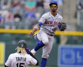 New York Mets shortstop Francisco Lindor, right, forces out Colorado Rockies' Raimel Tapia at second base on the front end of a double-play ball hit by Ryan McMahon in the first inning of a baseball game Sunday, April 18, 2021, in Denver. (AP Photo/David Zalubowski)