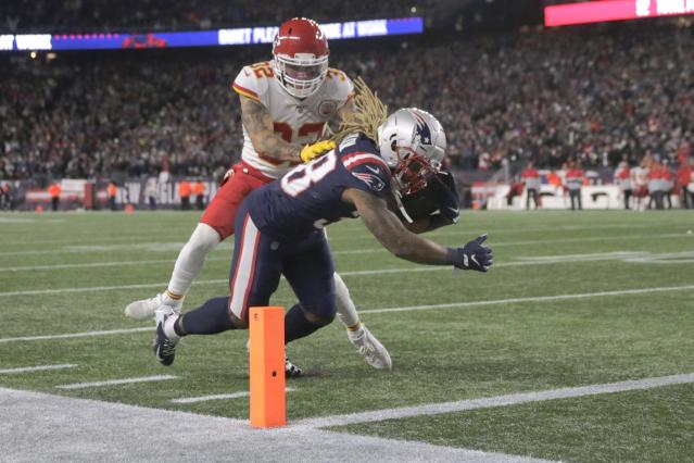 New England Patriots running back Brandon Bolden dives for the goal line and a touchdown in front of Kansas City Chiefs safety Tyrann Mathieu in the second half of an NFL football game, Sunday, Dec. 8, 2019, in Foxborough, Mass. (AP Photo/Charles Krupa)