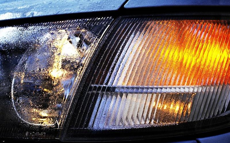 Car headlights are less simple than they used to be - Alamy