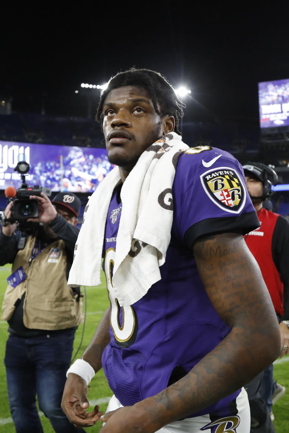 Baltimore Ravens quarterback Lamar Jackson leaves the field after an NFL divisional playoff football game against the Tennessee Titans, Saturday, Jan. 11, 2020, in Baltimore. The Titans won 28-12. (AP Photo/Julio Cortez)