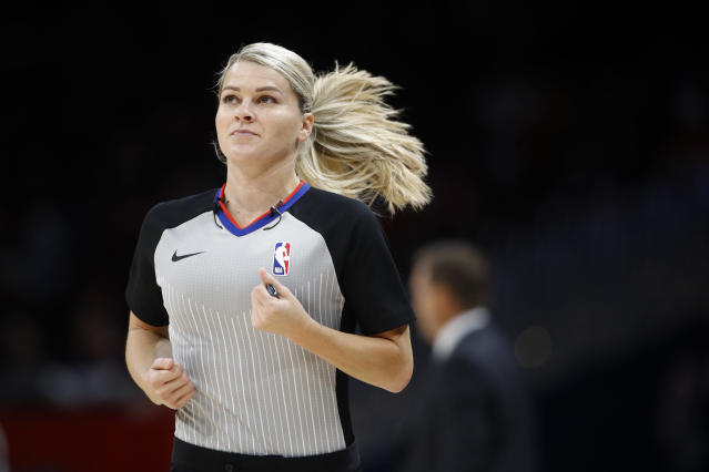 Referee Jenna Schroeder runs down the court in the first half of an NBA preseason basketball game between the Milwaukee Bucks and the Washington Wizards, Sunday, Oct. 13, 2019, in Washington. (AP Photo/Patrick Semansky)