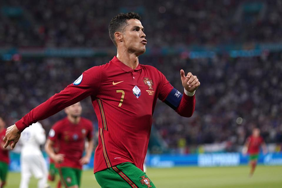 Ronaldo celebrates after scoring his second penalty of the game (EPA)