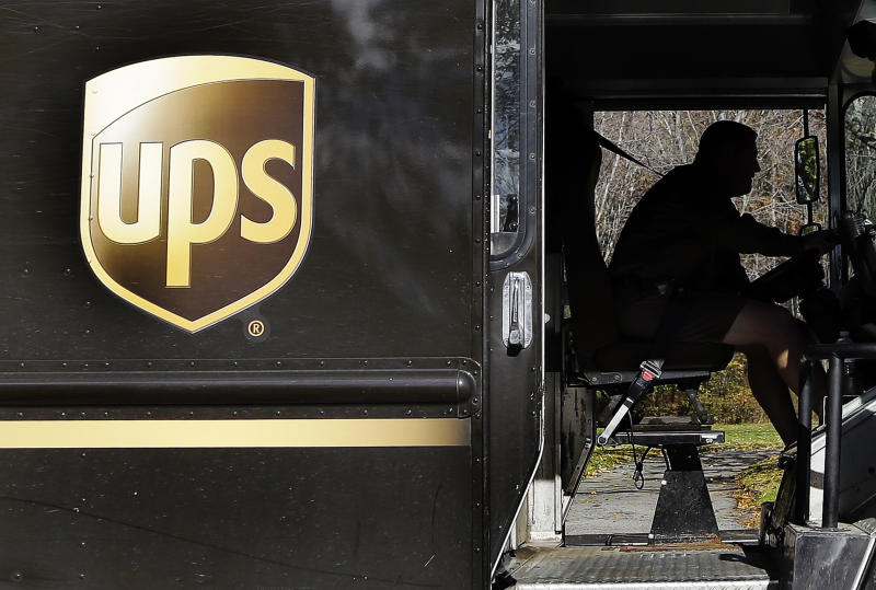 In this Monday, Oct. 22, 2012, photo, a UPS driver drives after a delivery in North Andover, Mass. In this Monday, Oct. 22, 2012, photo, a UPS driver makes a delivery in North Andover, Mass. UPS said Tuesday, Oct. 23, 2012,  its third-quarter earnings sank on a huge penalty to withdraw from a pension plan. Without that charge, net income fell slightly but matched expectations on Wall Street. The world's largest package delivery company is also narrowing its earnings forecast for the full year. (AP Photo/Elise Amendola)