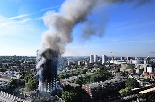 <p>A view on the burning Grenfell Tower, a 24-storey apartment block in North Kensington, London, Britain, June 14, 2017. (Andy Rain/EPA) </p>