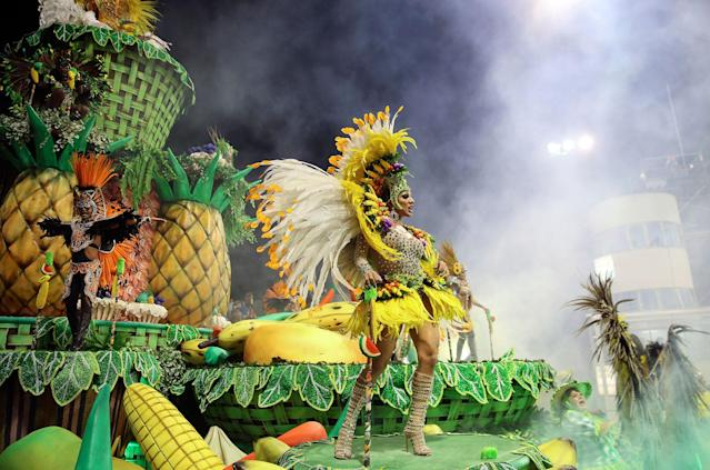 <p>Dancers from the Rosas de Ouro samba school perform on a float during a carnival parade in Sao Paulo, Brazil, Saturday, Feb. 10, 2018. (Photo: Andre Penner/AP) </p>