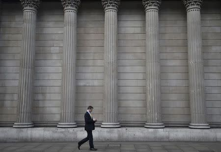 A man walks past the Bank of England in the City of London, Britain, February 14, 2017. REUTERS/Hannah McKay