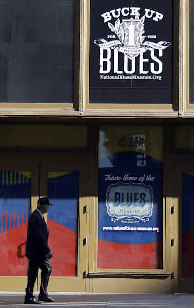 In this Wednesday, Sept. 25, 2013 photo, a man walks past past the site of the National Blues Museum, set to open next year, in St. Louis. Casual Blues fans may not immediately think of St. Louis when considering the genre, but organizers of the project say the city has its own rich musical history making it a deserving home for the national museum. (AP Photo/Jeff Roberson)