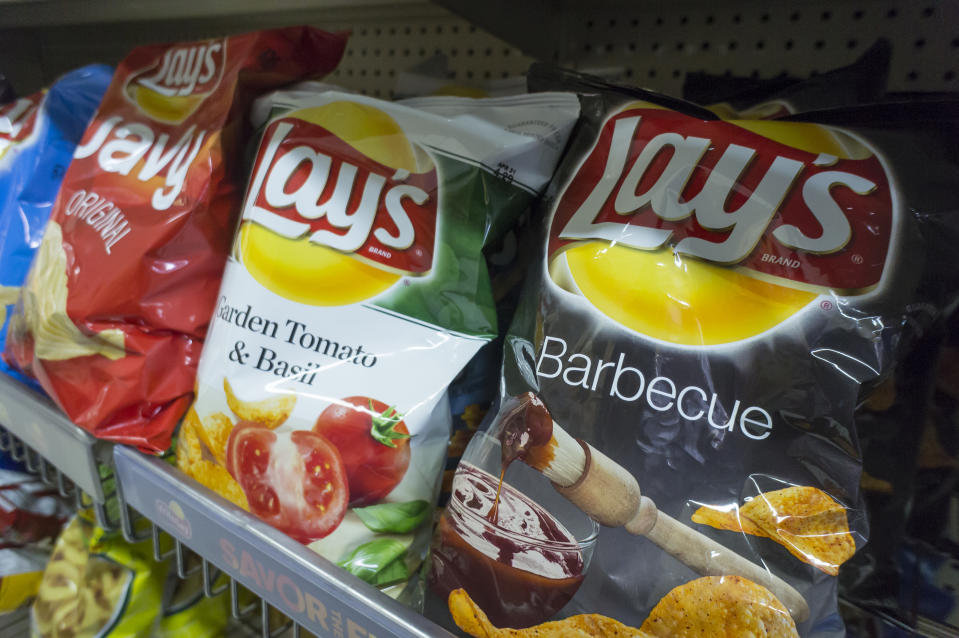 A display of PepsiCo Frito-Lay potato chip snacks in a supermarket in New York on Thursday, February 12, 2015. PepsiCo will report results for its fourth-quarter earnings on Thursday February 11, 2016, before the exchange opens, and analysts are expecting an increase in earnings driven by Pepsico's snack unit. (�� Richard B. Levine) (Photo by Richard Levine/Corbis via Getty Images)