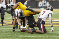 Missouri quarterback Kelly Bryant, center, loses the ball after hitting the ground between South Carolina defensive back Jammie Robinson, right, defensive back R.J. Roderick, left, during the second quarter of an NCAA college football game Saturday, Sept. 21, 2019, in Columbia, Mo. (AP Photo/L.G. Patterson)