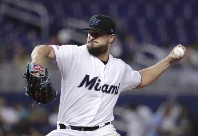 Miami Marlins starting pitcher Caleb Smith throws during the first inning of a baseball game against the Los Angeles Dodgers, Thursday, Aug. 15, 2019, in Miami. (AP Photo/Lynne Sladky)