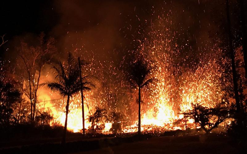 Lava fountains shoot 230 ft (70m) into the air in Leilani Estates, Hawaii - AFP