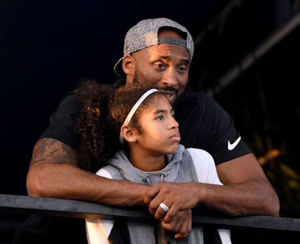 PHOTO: Kobe Bryant and daughter Gianna Bryant watch the National Swimming Championships at the Woollett Aquatics Center on July 26, 2018, in Irvine, Calif. (Harry How/Getty Images, FILE)