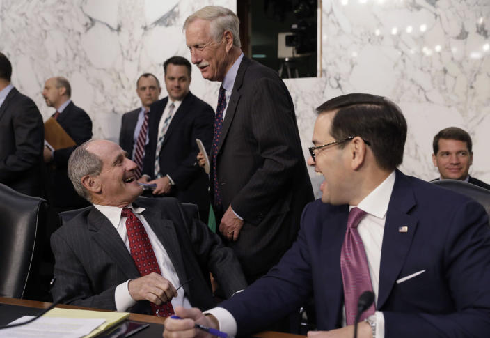 """<p>Senators James Risch (L), Angus King (C) and Marco Rubio laugh together before the start of Former FBI Director James Comey's testimony before a Senate Intelligence Committee hearing on """"Russian Federation Efforts to Interfere in the 2016 U.S. Elections"""" on Capitol Hill in Washington, June 8, 2017. (Photo: Jim Bourg/Reuters) </p>"""