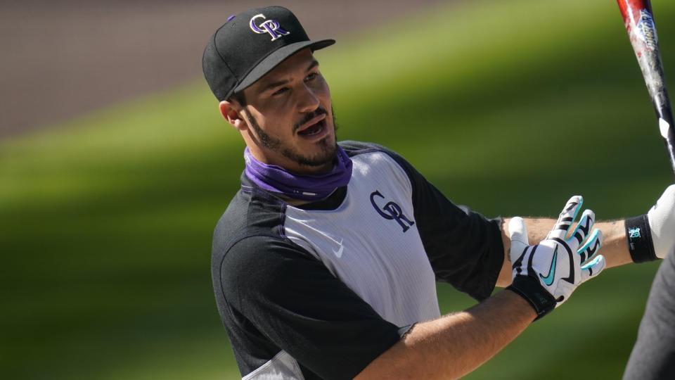 Colorado Rockies third baseman Nolan Arenado (28) warms up before a baseball game against the Saturday, Sept. 12, 2020, in Denver. (AP Photo/David Zalubowski)