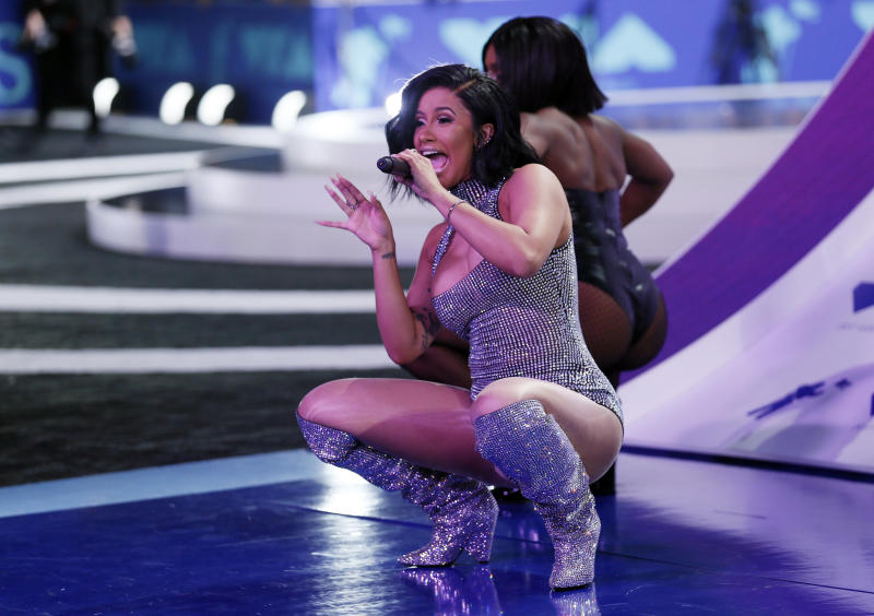"Cardi B <a href=""http://www.mtv.com/video-clips/qiuc2k/vma-2017-cardi-b-live-bodak-yellow-vma-2017-mtv"" target=""_blank"">performed in the boots</a> during a VMA pre-show in August. (Danny Moloshok / Reuters)"