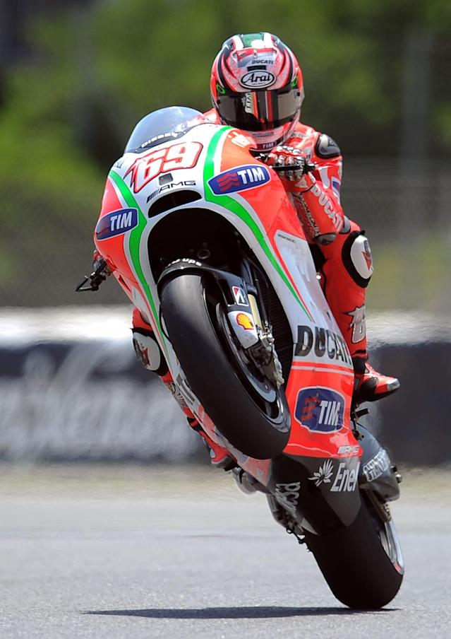 Ducati Team'sUS Nicky Hayden of makes a wheelie at the Catalunya racetrack in Montmelo, near Barcelona, on June 1, 2012, during the MotoGP second training session the Catalunya Moto GP Grand Prix. AFP PHOTO/LLUIS GENELLUIS GENE/AFP/GettyImages