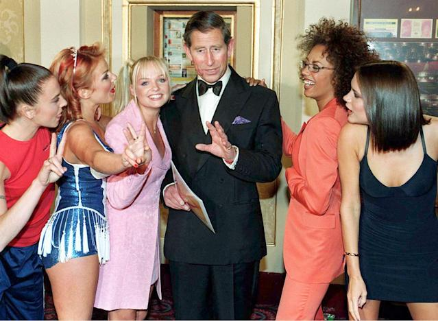 During a meet and greet with Prince Charles, the Spice Girls caused a stir when Ginger Spice pinched his bottom and left lipstick on his face. (Photo: Getty Images)