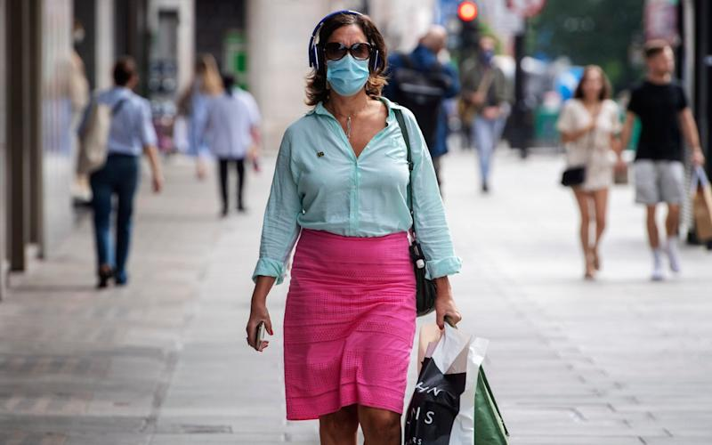 A shopper wearing a mask in London ahead of the rules being implemented - Paul Grover for the Telegraph