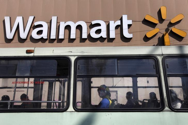 A clown sits inside a bus seen in front of a Wal-Mart store in Mexico City