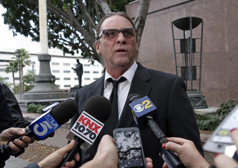 FILE - In this Jan. 8, 2018, file photo, Michael Channels speaks to reporters after a hearing in Los Angeles Superior Court in Los Angeles. A Kern County Superior Court commissioner ruled Monday, March 12, 2018, that Jason Freeman of Florida can collect the remains of Charles Manson from the morgue in Bakersfield, Calif. Channels had also sought to claim Manson's body. (AP Photo/Brian Melley, file)