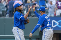 Toronto Blue Jays' Vladimir Guerrero Jr., left, and manager Charlie Montoya, right, celebrate their victory over the Texas Rangers in a baseball game Monday, April 5, 2021, in Arlington, Texas. (AP Photo/Jeffrey McWhorter)