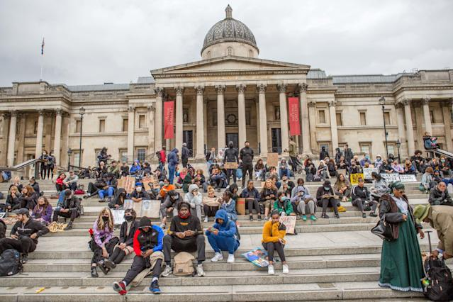 Protesters seen at Trafalgar Square with BLM placards during the demonstration. Protesters from the Black Lives Matter campaign demand justice for George Floyd and an end to Police violence in London. (PA)