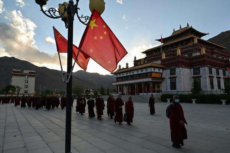 Chinese flags and the aphorisms of President Xi Jinping pepper the college grounds