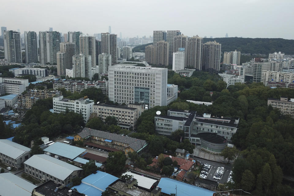 This Wednesday, Oct. 21, 2020 photo shows the campus of the Hubei Provincial Center for Disease Control and Prevention in Wuhan in central China's Hubei province. Hubei CDC staff carried out evaluations of coronavirus testing kits days before China made sequences of the virus publicly available, allowing three companies to make testing kits ahead of competitors. The move delayed China's response to the outbreak and caused critical shortages of kits. (AP Photo/Dake Kang)