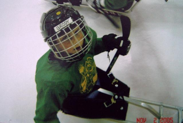 In this Nov. 2, 2005 photo provided by the family, Brody Roybal plays with hockey sled teammates in Bensenville, Ill. Brody started playing sled hockey at 7 for the Hornets, a youth sled hockey team in the Chicago area. He's now a member of the U.S. Paralympic sled hockey team which will play in Sochi, Russia in March 2014. (AP Photo/Family Photo)