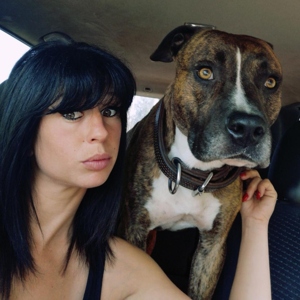 Elisa Pilarski, 29, with one of her pet dogs.